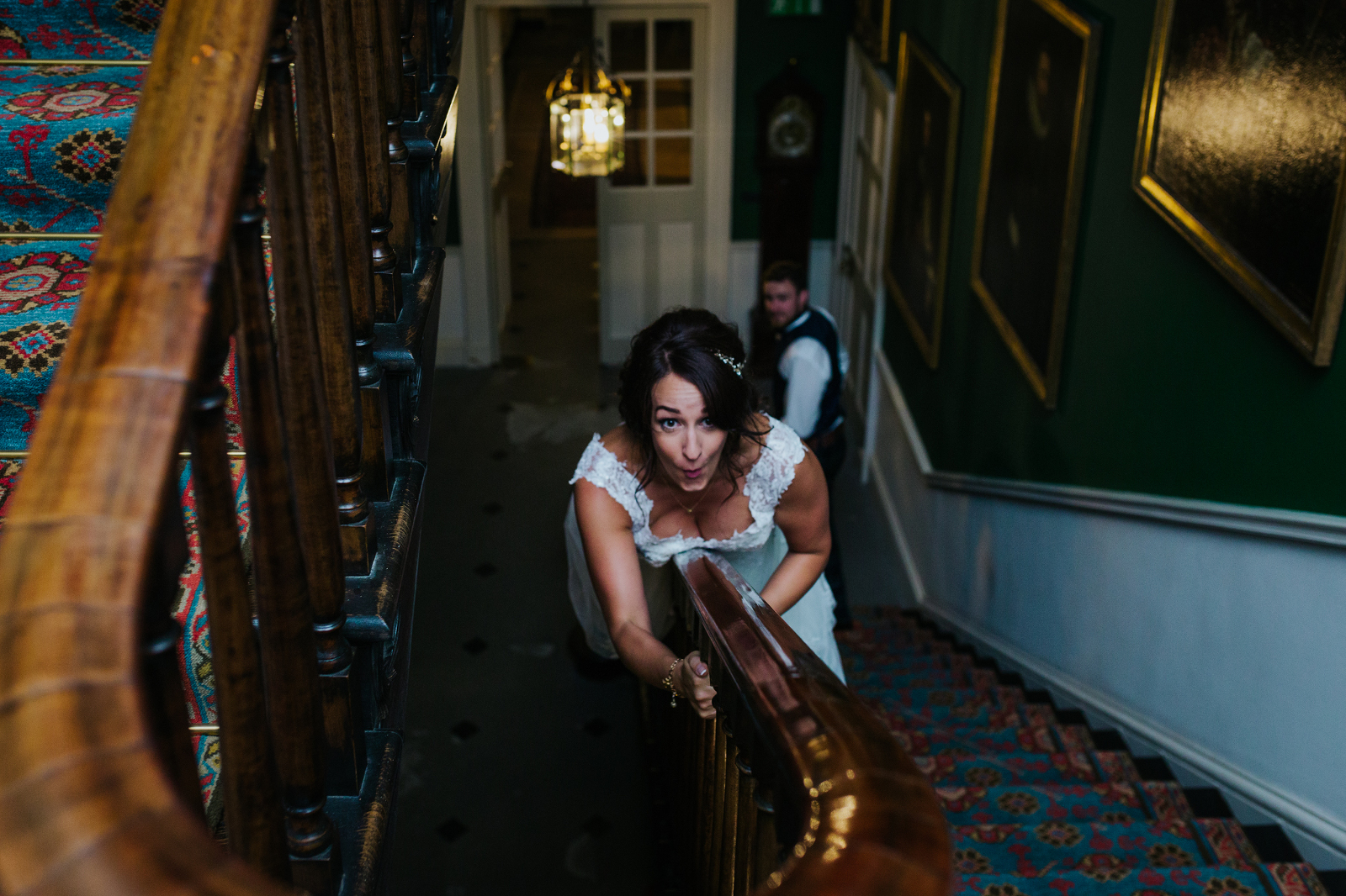 bride-sliding-down-bannister-in-wedding-dress