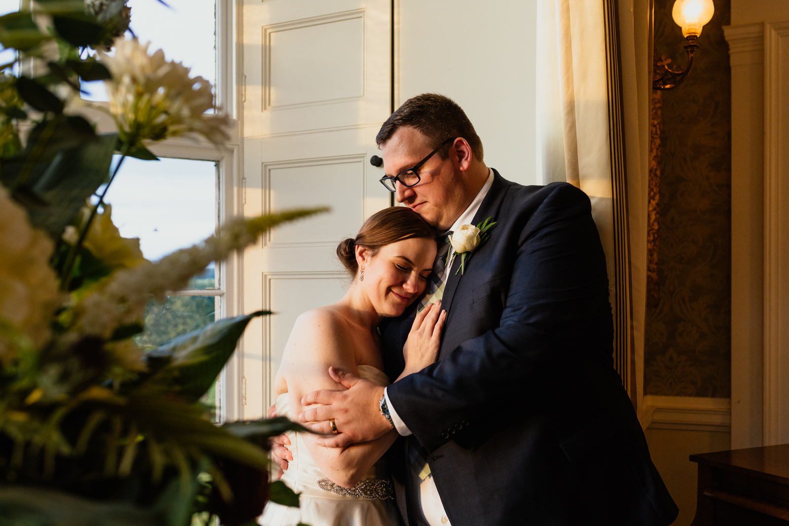 bride-groom-standing-in-golden-light-at-blairquhan-castle
