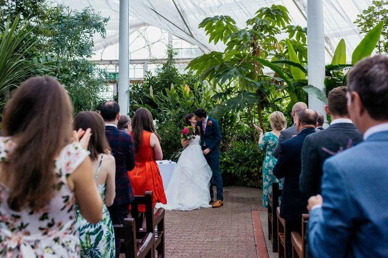 wedding-winter-gardens-ceremony-bride-groom-first-kiss