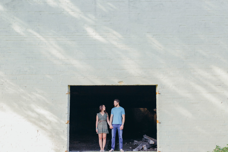 couple-standing-side-by-side-in-doorway-symmetry