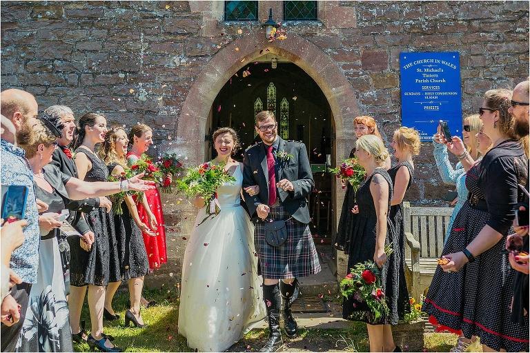 bride-groom-walking-through-confetti