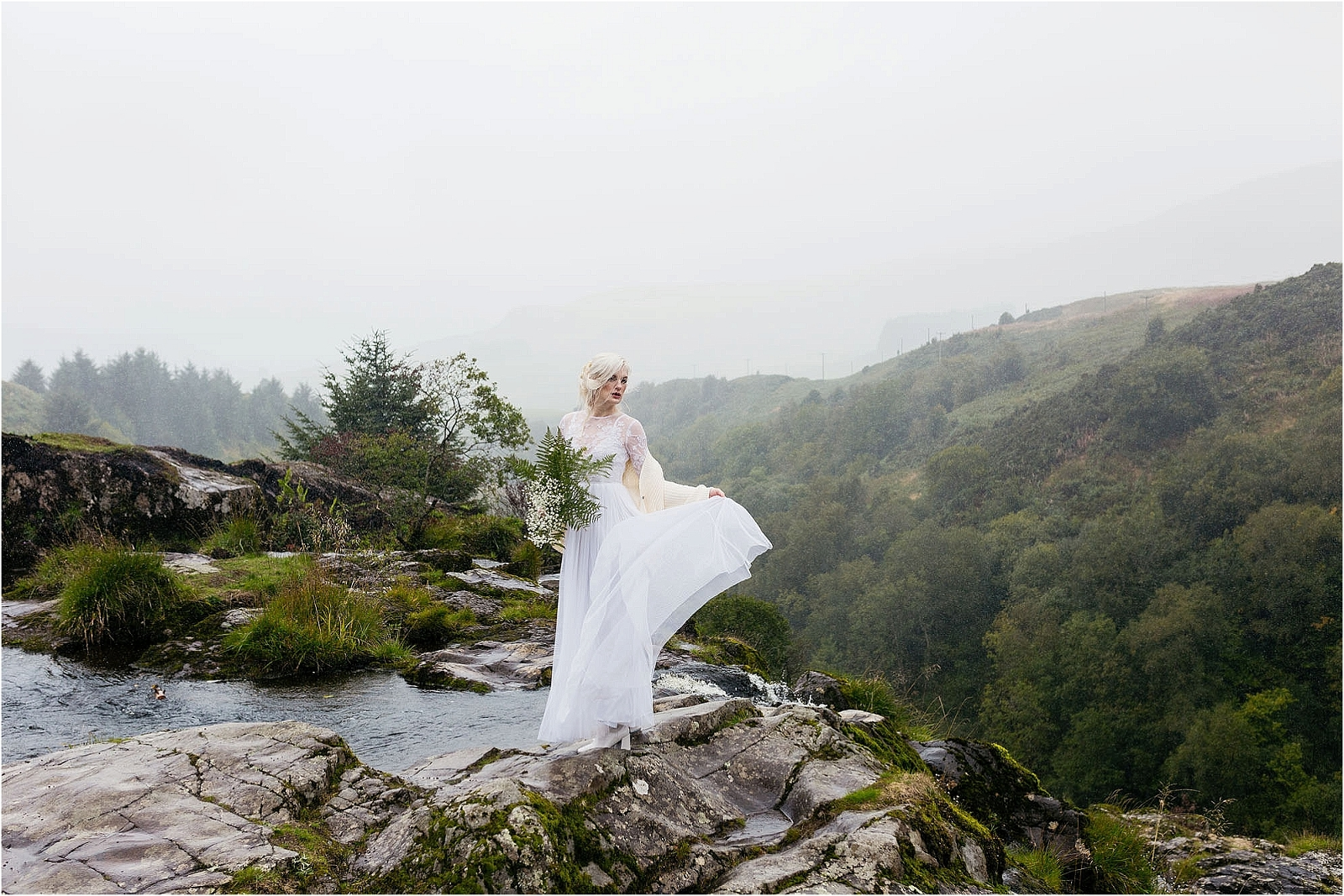 bride-standing-on-top-of-fintry-waterfall