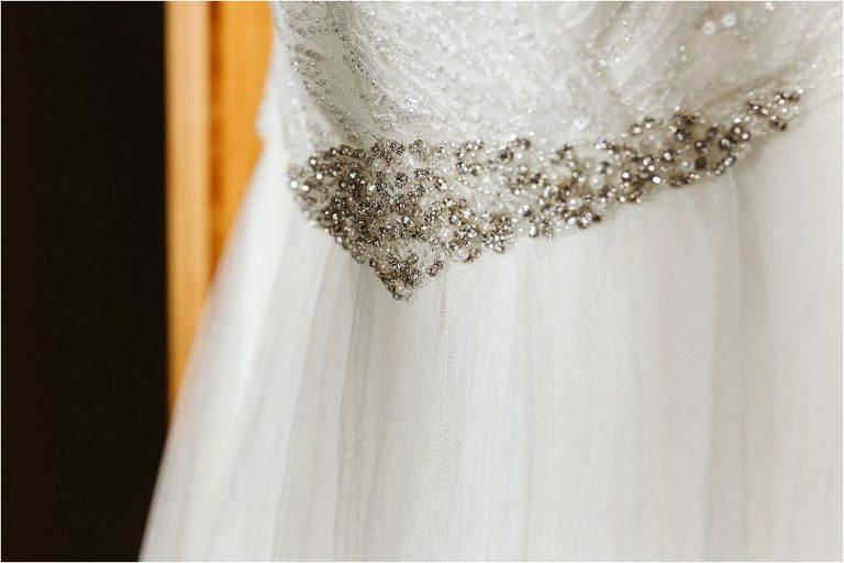 detail-photo-of-diamantes-on-wedding-dress