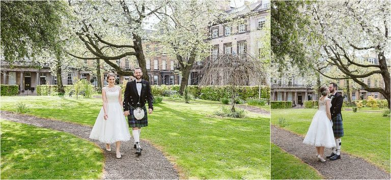 bride-and-groom-walk-through-private-garden-with-cherry-blossom-in-blooming