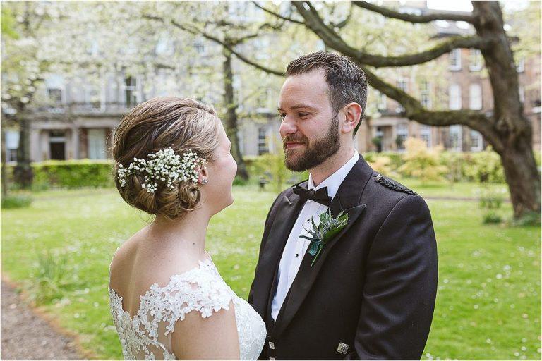groom-looks-loving-at-his-wife