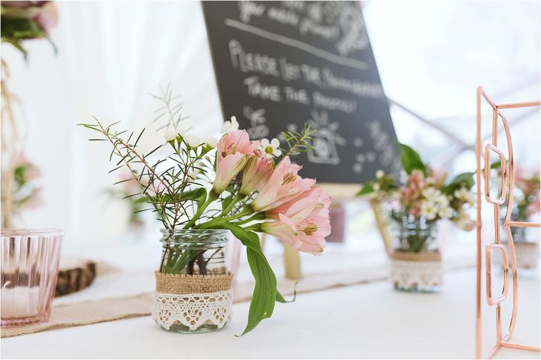 alstroemeria-flowers-in-a-small-jar-with-hessian-and-lace